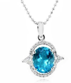 LenYa presents an outstanding example of craftsmanship; a small and beautiful pendant which is laced with the best quality Cubic Zirconia and comes with a gorgeous Oval Brilliant Blue Topaz at the center. The main stone Blue Topaz is of the highest quality and will glitter and dazzle with an unmatched radiance and will go well with an evening dress or a gown.