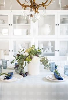 Simple blue and green centerpiece using grocery store flowers .