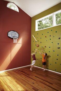 rock wall in basement near basketball court
