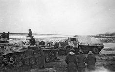 Totenkopf troops pull a stuck truck out, Kharkov 1943