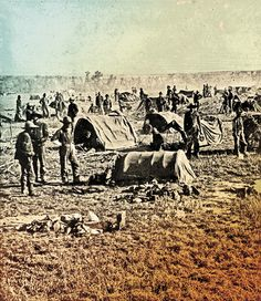When the food ran out after 15 days, Gen. George Crook's troops were not only weary and starving, they had to make camp without fires to warm the chill out of their bones. Shown here are Crook's men on the field along Whitewood Creek, in Dakota Territory, at the end of the 1876 starvation march.  – Courtesy National Archives and Records Administration –