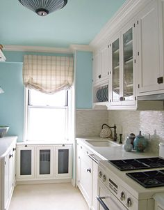 "BENJAMIN MOORE WOODLAWN BLUE HC-147: ""Wedgwood Gray and Woodlawn Blue have that robin's egg vibe. I always hedge my bets toward grayed-down shades, because bright colors that look so happy in the paint store can look bizarre in real life. If you're nervous, start by painting the back wall inside the cabinets."" -Clare Donohue Color has more impact when it extends to the ceiling. Here it's painted Woodlawn Blue HC-147, a lighter version of the Wedgwood Gray HC-146 on the walls. Cabinets are…"