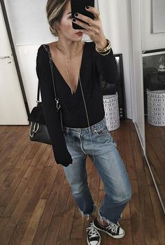 sensual and sexy black plunging top with jeans