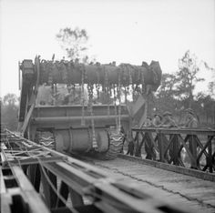 A Sherman Crab flail tank crosses a Bailey bridge over the Orne, as it moves up to the start line for Operation 'Goodwood', 18 July 1944.