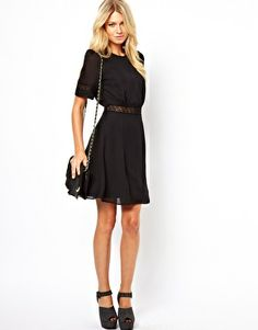 $81.40 with the lace details it's still not too exciting. classy and moderate. better as a work dress or for formal occasions. Image 4 ofASOS Skater Dress With Lace Band Detail
