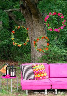 Hung staggered in the trees, a group of hula hoops wrapped in silk flowers makes for a festive photo-op backdrop. Get the tutorial at Uncommon Designs »  - GoodHousekeeping.com