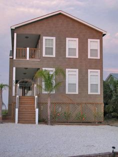 Two story modular home design with shake siding that withstands the harsh coastal weather and looks great. Built by Nationwide Homes and our independent builder.