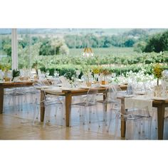 Love the rustic table, ghost chairs and runner. I'd like a little more flowers and candles.