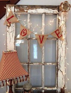 Old Window Decorated With Lights And Burlap
