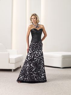 Montage by Mon Cheri - 112932 - Strapless satin A-line dress with sweetheart neckline, asymmetrically ruched bodice with asymmetrically dropped waistline, cut-out embroidered full skirt with sweep train. Matching shawl and removable straps included.Sizes: 4 - 20Colors: Champagne, Black/Silver