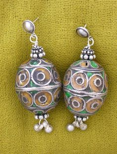 by Anna Holland | Very old enamelled beads that Anna found in Taguemout, Morocco have been converted into earrings using sterling silver components | Sold