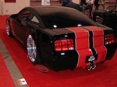 Black with red stripes rear shot.