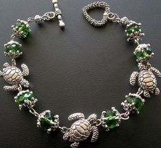 Hey, I found this really awesome Etsy listing at http://www.etsy.com/listing/91808007/turtle-bracelet-jewelry-green-turtle