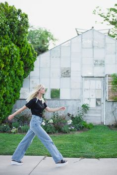 Long and lean for summer in the wider strider jeans, low rider flatforms, and playing favorites tee by Nasty Gal.