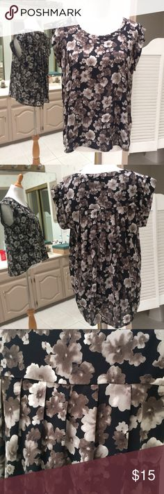 Short Sleeve Floral Print Blouse Style this beautiful and a bit edgy blouse with black dress pants or skinnies and accessorize with a long silver necklace. You'll enjoy the relaxed fit due to draped back and the lightweight flowy fabric. The floral print is adorable, but also edgy because of the colors (black, grey, dark taupe).  Hi-lo hem. 100% polyester. Hand wash. Very gently used. Great condition. Pleione Tops Blouses