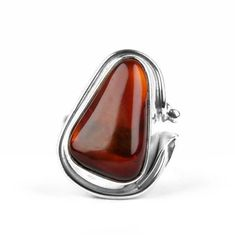 """Cherry Amber & Sterling Silver Ring Item No. AM03327A01 $118.29 This fairly large ring consists of a genuine cherry amber gemstone that is set in a thick and stylized bar of sterling silver. The one side has a leaf and ball adoration. The entire face, or top, of this ring is 1 1/4"" long and 3/4"" wide, and the ring sits about 1/2"" high off the finger. Get noticed with awesome amber jewelry with a ring like this one-of-a-kind hand-crafted one!"""
