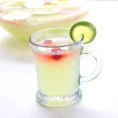 Limeade Punch  1 (12 ounce) can frozen limeade concentrate  1 (2 liter) bottle Sprite  frozen raspberries or sliced limes for garnish  ice