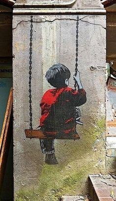 Boy on a swing Street Art