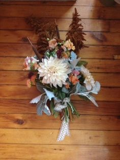 The Cafe Au Lait dahlia goes very autumn in this bridal bouquet featuring amaranth, dusty miller, cat tails and more! A beautiful rustic wedding palette by Gold Dust Floral