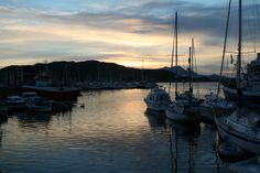 Midnight sun over Bodo Harbour Norway.  July 2006
