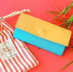This stylish large wallet clutch is designed and handcrafted made by me using vegan leather (faux leather) in beige, turquoise and pink color. This is a perfectly sized womens wallet, (7.5 x 4 when closed, 19.5cm x 10.5cm) and with enough compartments to keep you organized, it has four (4) card slots with plenty of room for 2-3 cards in each slot, a pocket with zipper for coins, two long compartments for cash, receipts, coupons, a checkbook , movie tickets , bus pass, iPhone you name it and…