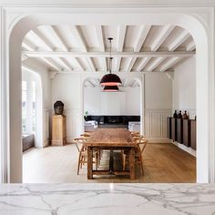 Marble details offset the traditional features of this 19th-century house near Paris, which has been renovated by Spanish studio 05 AM Arquitectura. The aim was to add a contemporary aesthetic to the traditional layout and original features of the house. See more photos at dezeen.com/architecture #architecture #house #renovation #Paris #marble Photograph by Adrià Goula Sardà.