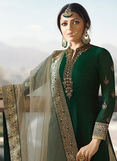 Green And Golden Embroidered Lehenga Kurti Set is especially crafted for showcasing glamorous style and ethnic elegance with its unique embroidered combination of zari and resham thread work annota. Latest Punjabi Suits Design, Indian Designer Suits, Embroidery Suits Punjabi, Kurti Embroidery Design, Old Fashion Dresses, Fashion Outfits, Man Fashion, Fashion Killa, Fashion Pants
