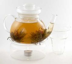 Clear Teapot with Infuser  Watch your tea brew in this magnificent glass teapot. Made to resist extreme heat, the built-in glass infuser makes brewing easy. Great for flowering teas! Holds 1.3 litres. Warmer and tealight not included.