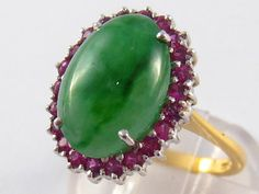 An 18 carat gold jade and garnet ring, jade approx 15 x 10mm, ring size N, 6.4 gms.