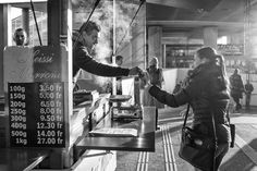 It's that Time Again Vendor handing a small bag of chestnuts to a lady outside Hardbrücke train station in Zürich. Because of the low temperature the backlight is broken by some steam. Street Pictures, Train Station, The Outsiders, Lady, Switzerland, Lighting, Lights, Lightning