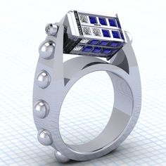 This Doctor Who Spinning TARDIS Ring. I NEED THIS!!! Or one of the other AMAZING rings in this artist's shop.