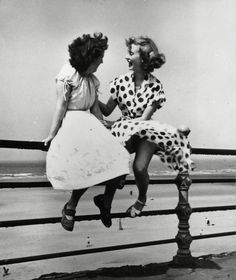 Two women on the beach in Blackpool, UK.