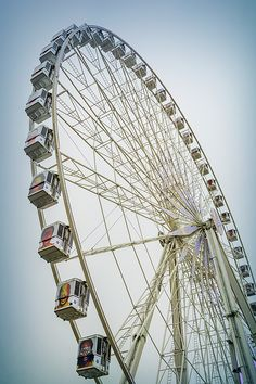 Love the perspective in this photo by Joan Carroll. via @joancarroll #paris #ferriswheel @joan1992