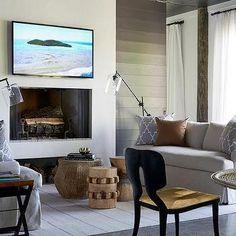 Flatscreen TV Mounted Over Sleek Fireplace