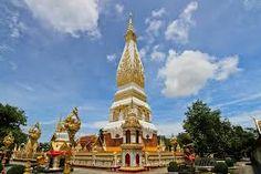 พระธาตุพนม ประดิษฐาน ณ วัดธาตุพนมวรมหาวิหาร อำเภอธาตุพนมห่างจากตัวจังหวัดประมาณ 50 กิโลเมตร เป็นสถานที่เคารพนับถือทั้งของชาวไทยและชาวลาว ตำนานกล่าวว่าผู้สร้างคือ                      พระมหากัสสปะพระอรหันต์ 500 องค์ และท้าวพระยาเมืองต่าง ๆ ภายในองค์พระธาตุบรรจุพระอุรังคธาตุ                              ของพระสัมมาสัมพุทธเจ้าไว้ ลักษณะของสถาปัตยกรรมมีแหล่งที่มาที่เดียวกันกับปราสาทของขอม