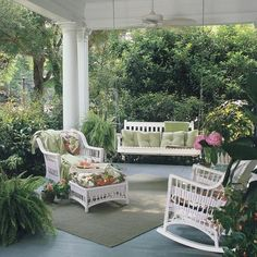 large porch in lush garden setting by trisha