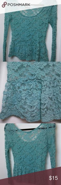 """Lily Rose sz. S lace peplum top This cute lace shirt is a mint green/turquoise blue in colour, has a peplum style skirt around the midriff, and is made of a stretchy lace. The size tag has been cut off but fits like XS/S. Long sleeves measure 19"""" from armpit to wrist, and 25"""" from shoulder to wrist. Lily Rose Tops Blouses"""