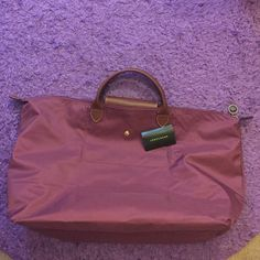 SALEBeautfiul Berry Auth Long Champ Carryon Send offers! Never used. Absolutely beautiful. Perfect for travel, sleepovers, or an every day bag! Longchamp Bags Travel Bags
