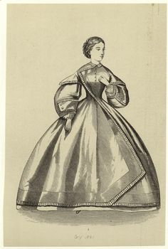 1861 Day dress from Godey's magazine. This is one of those dresses which I think qualifies as belonging on their ACW era runway.  I don't see this as a common fashion.