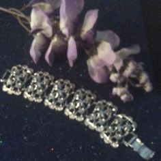 Silver Bracelet Beautiful silver bracelet has two tiny marks on clasp.not noticeable while wearing the bracelet. This bracelet is stunning Jewelry Bracelets
