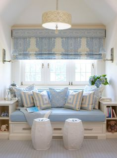 window seat with shelving on the side and storage drawer underneath