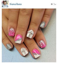 Pink, white, glitter nails. Grey nails with a cross.