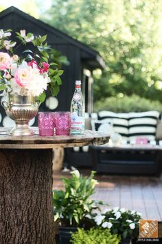 A tree stump becomes an outdoor serving table in this gorgeous backyard makeover by Kristin Jackson of The Hunted Interior. See more photos on The Home Depot Blog.
