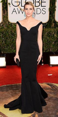 Emma Roberts in a Lanvin gown, Jennifer Meyer jewelry, and Kotur bag at The 2014 Golden Globes