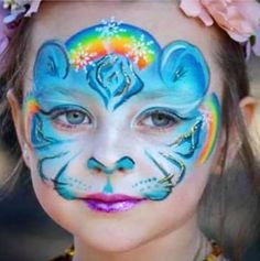Leanne can sneak a rainbow into any face painting design! We love this tiger that she painted with pearly blues, snowflake stencils, Liquid Bling and, wow, look at those pink lips!