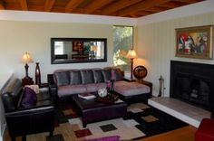 Living room with fireplace in this 2 bedroom, 2 bathroom Belvedere Tiburon, CA home.
