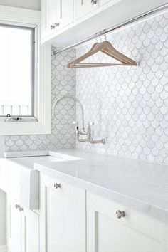White scalloped tiled laundry room with hanging rack above sink! So pretty and so functional! The English Tapware Company. Such a clean looking laundry room. Laundry Room Storage, Laundry In Bathroom, Bathroom Shelves, Wall Shelves, Laundry Cupboard, White Laundry Rooms, White Bathrooms, Laundry Closet, Wardrobe Storage