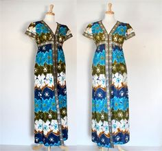 VINTAGE 70s BATIK HAWAIIAN INSPIRED MAXI DRESS   Great transitional styling, this dress is made in a heavy tie dye linen or cotton print. The accent trim is gold and blue metallic - the shimmer does not photograph but it is very festive. The dress has a v neck, short sleeves. empire waist, princess seams, two on seam side pockets, full back nylon zipper, and a high front slit. The dress is fully lined in light blue linen. This is an extremely well made, high end dress. There is no designer…