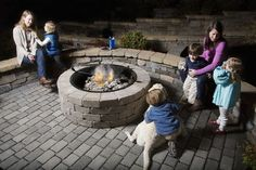 The Ashland firepit comes with the choice of an insert with grill grate or decorative rock face coping.  The insert with grill grate is perfect for grilling hot dogs and more! #Firepits #LiveOutside