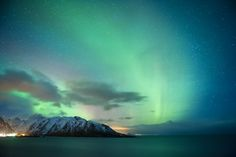 The northern lights, visible on clear nights for many of the winter months, swish across the sky near Reine.